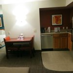 View of the kitchenette and dining table, looking into the bedroom area