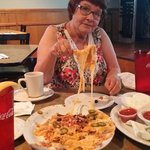 """My grandma eating nachos with...""""A sarcastic amount of cheese. """"  Great place with great food!"""