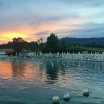 Sunset over the hotel's thermal pool