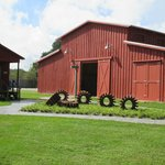 Mule barn with agricultural equipment exhibition