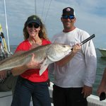 Sheri's bull red fish along with Captain Mike.