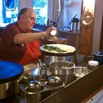 Yvon making our first crepe with eggs and reindeer sausage