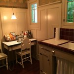 Part of the garden cottage kitchen - check out part of the minibar on the table.  Vintage, charm