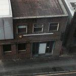 Massage parlour right outside window.