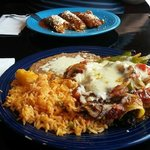 Enchilada plate, and meat filled tamales, delicious and served on oversized plates.
