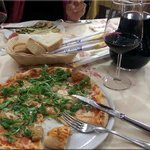 Porcini and arugula pizza with a pitcher of Barbera