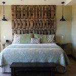 bed with wine barrel headboard