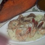 Scampi on white rice served with drawn butter along with baked sweet potato.