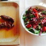 Fresh salad and Italian sausage