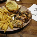 Chicken meal with chips and garlic bread side