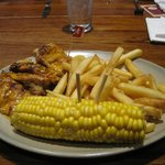 Chicken meal with chips and corn side