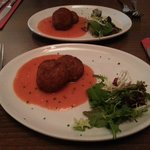 Starter - crab cakes with pepper sauce.