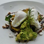 Corn fritters,  avocado,  poached eggs baby spinach,  delicious