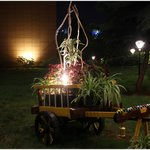At the entrance. Decorated miniature cart....