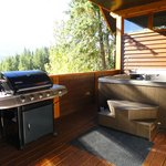 Deck/hot tub/grill..not pictured is the small dining table on the deck