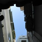 Looking up from ground-floor room patio