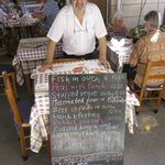 Laona restaurant owner with the menu of the day