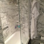 Shower & robe in King studio suite at The Marylebone in London