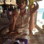 My fella enjoying the fresh pineapple juice with breakfast