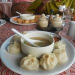 Hot steamed momos served with soip