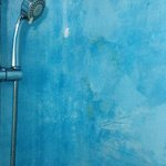 Run down and unhygienic bathroom with flaky paint...