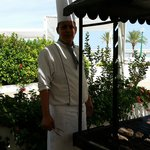 lovely chef cooking BBQ at pool restaurant