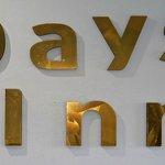 Crooked Days Inn logos above main reception desk