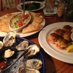 Crab dip with pita wedges, stuffed shrimp, raw oysters