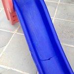 Broken slide in kids area