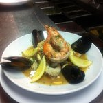 Seafood boullibaise. With whole and tail prawns, squid, snapper, scallops and mussels. Served wi