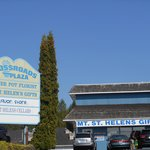 A multi business sign for Mt. St. Helen's Gifts and other business's.