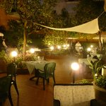 View of garden restaurant from bar area at night