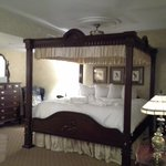 four poster and an easy chair ...