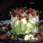 crab avocado salad appetizer with bruschetta (side view)....