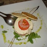 prawn tartar served with mozzarella, roket, olive oil and tosted bread