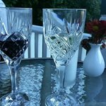 A glass of white and a glass of red on the terrace