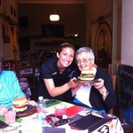 Cassie and her 86yr old grandma from California eating the LONG BEACH burger.Bacon, grilled onio