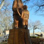 Wood sculpture of a Susquehannock Native American and child