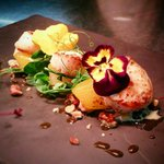 Pan seared black pearl scallops with saffron poached pear, chopped walnuts and blue cheese sauce