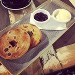 Baked raisin bagel with mascarpone and morello cherry jam