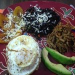 Pabellón - Venezuela's national dish. Ripe plantains, black beans, shredded beef, fried egg on r
