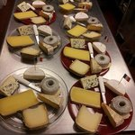Cheese plates for a French cheese and wine tasting event.