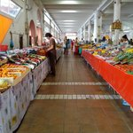 One of the main aisles of the market showing pasta and fresh fruit