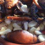 Garlic mushrooms, with still-sizzling garlic