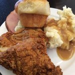 Ham, mashed potatoes, gravy, roll and fried chicken!