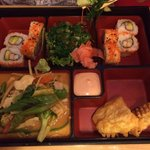 Box with red curry, Cali roll, seafood salad and sweet potato tempura