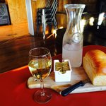 Fresh loaf of brioche bread with a glass of Kendall Jackson Chardonnay