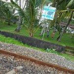 Chitra - rail track between resort and beach