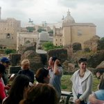 Paul shares a laugh with a tour group on Palatine Hill ruins, Rome.