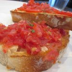 Fresh tomatoes on crusty soft bread